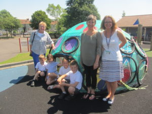 Youth arts co-ordinator from the Art society, school pupils, Nina Gronw-Lewis of ACEarts and Class teacher with pupil designed and built 'podule'.