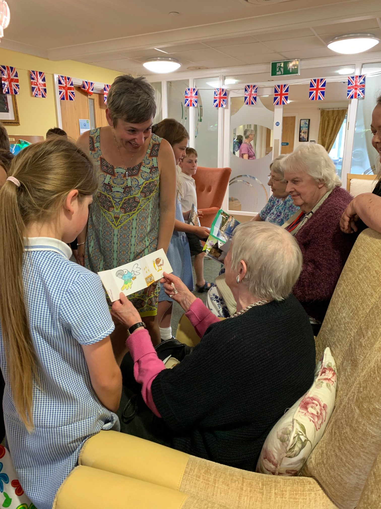 elders and school children at Wessex House care setting celebratory event where participants shared the books they produced during our project 'Suitcase Library'.